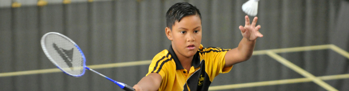 Young boy plays badminton in Gisborne